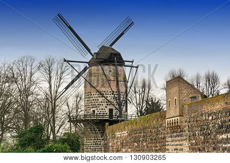 Old historic windmill in Zons am Rhein Germany.
