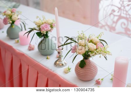 bouquet of flowers in a vase at the wedding table in a restaurant.