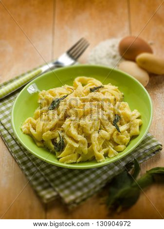 homemade tagliatelle with butter sage and parmesan cheese, selective focus
