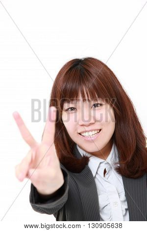 young Japanese businesswoman showing a victory sign