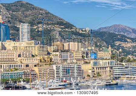 View on Monaco from the harbor with yachts to houses that go the the sky