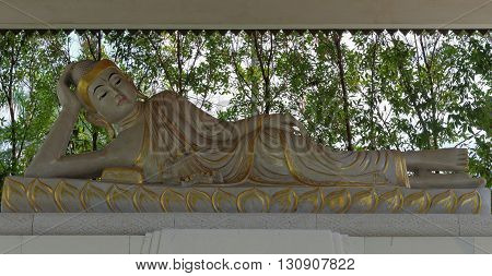 reclining buddha statue in mendut buddhist monastery