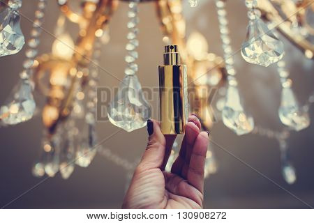 little female  bottle of perfume in gold colors