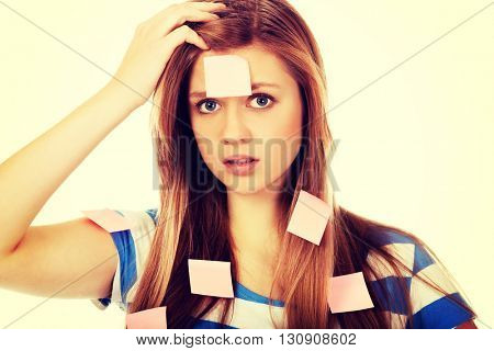 Teenage woman covered with post it notes