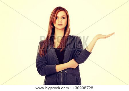 Teenage woman presenting something on open palm