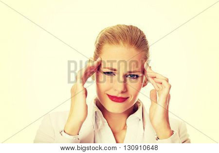 Business woman wtih huge head ache