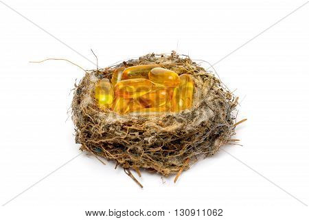 Picture of a Cod liver oil omega 3 gel capsules in sparrow nestC