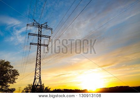 high voltage post. High-voltage tower sunset or sunrise sky background.
