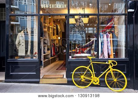 London England - January 29 2012: A store with yellow bycicle in Portobello road