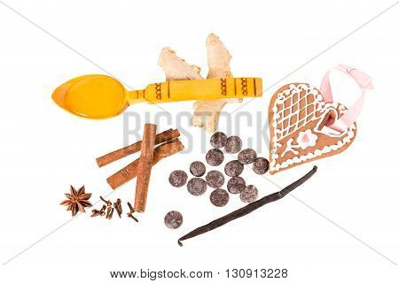 Assorted chocolate and spices for christmas mulled wine. Isolated on a white background.