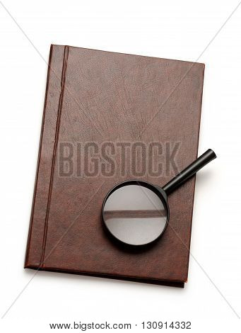 Notepad And Magnifying Glass