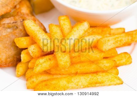 Traditional british fish and chips with tartar sauce and fresh lemon. Macro. Photo can be used as a whole background.