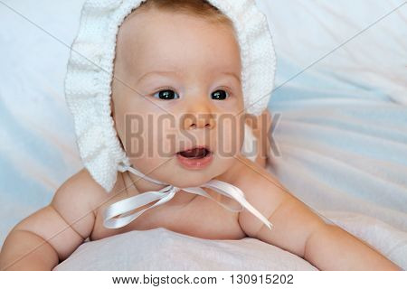 an innocent baby on a white background