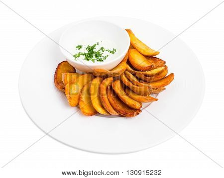 Crispy roast potato wedges with tartar sauce. Isolated on a white background.