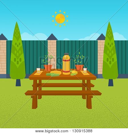 Summer picnic. Table with food and drink. Outdoor picnic house backyard.