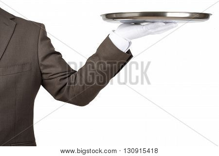 Arm in white glove with empty flat plate isolated on white background