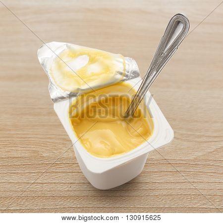 Open Yogurt In Pot With Metal Spoon