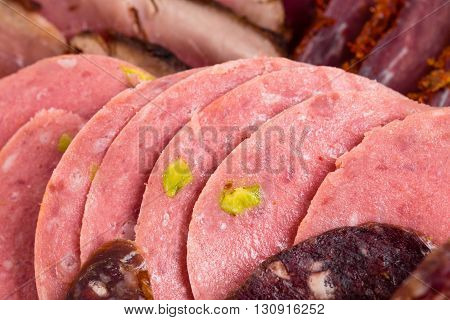 Closeup of delicious assorted meat platter with roast beef and mortadella. Macro. Photo can be used as a whole background.