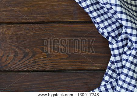 wooden domestic background with checkered kitchen towel, napkin