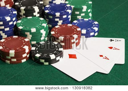There are a lot of poker chips and three cards