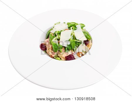 Warm grilled chicken salad with parmesan and fresh corn salad. Isolated on a white background.