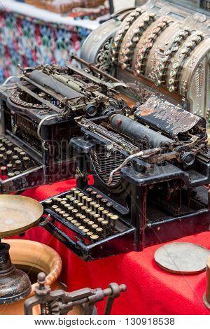 two vintage typewriters on street flea market
