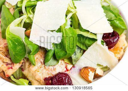 Warm grilled chicken salad with parmesan and fresh corn salad. Macro. Photo can be used as a whole background.