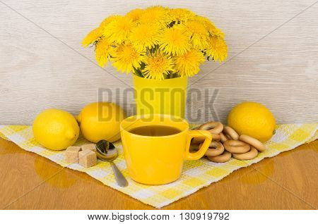 Tea With Sugar And Lemon, Bagels And Bouquet Of Flowers
