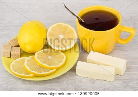 Tea With Candy, Lemon And Sugar