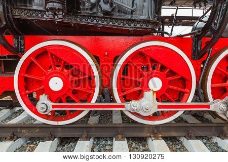 The close-up wheels of the old steam train