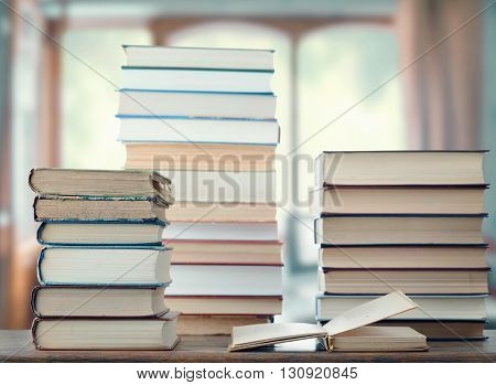 Stack of books on a table in the room