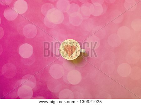 photo of the white cup of coffee on the pink background