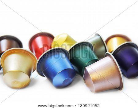 Multicolored coffee capsules, isolated on white background