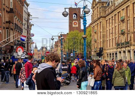 Amsterdam, Netherlands - May 4: The residents and guests of the Netherlands on the main street Damrak celebrate of Memorial Day  May 4, 2013 in Amsterdam, Netherlands.