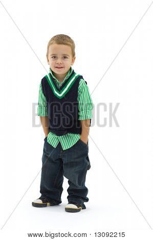 Portrait of preschoold boy posing green shirt and jeans, isolated on white.