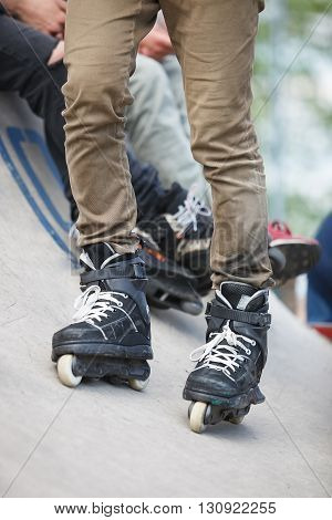 Feet Of Aggressive Inline Rollerblader On Outdoor Skatepark