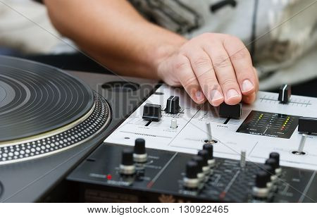 Dj Mixing Music On Professional Sound Mixer