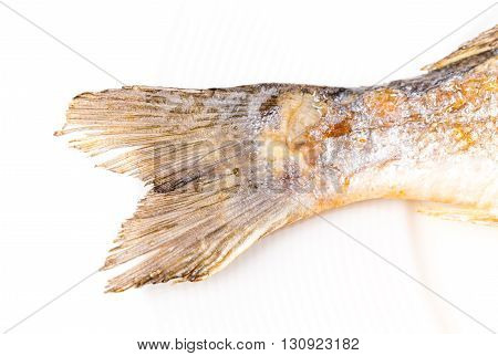 Closeup of grilled seabass tail. Macro. Photo can be used as a whole background.