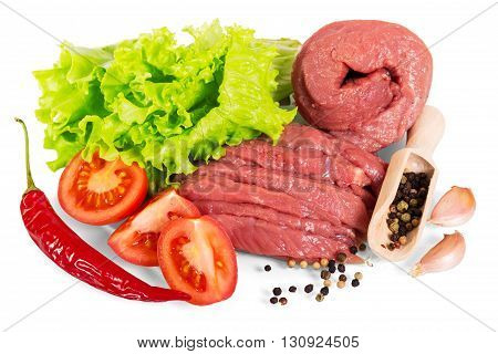Raw beef with spices, lettuce and tomatoes isolated on white background.