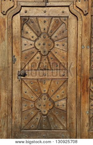 Old and ancient door in the city of Prague
