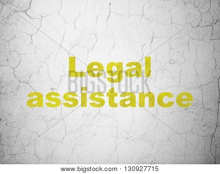 Law concept: Yellow Legal Assistance on textured concrete wall background