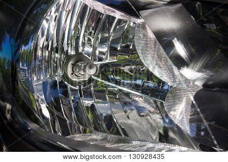 Modern high beam headlights on a car close up