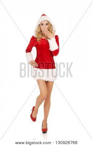 Shocked young beautiful santa woman