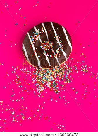 Donuts on pink background.