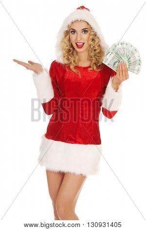 Beautiful santa woman holding a clip of polish money