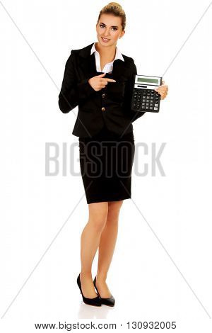 Happy businesswoman holding a calculator