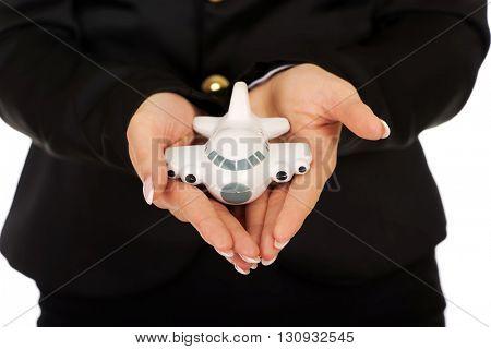 Businesswoman presenting plane model in hand