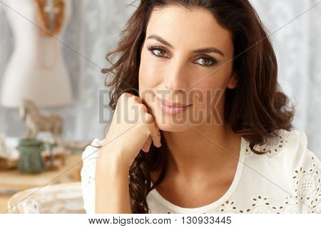 Closeup portrait of beautiful young woman looking at camera.