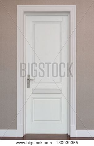 closed white door on brown wall background
