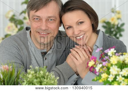 Portrait of Beautiful smiling couple in flowers